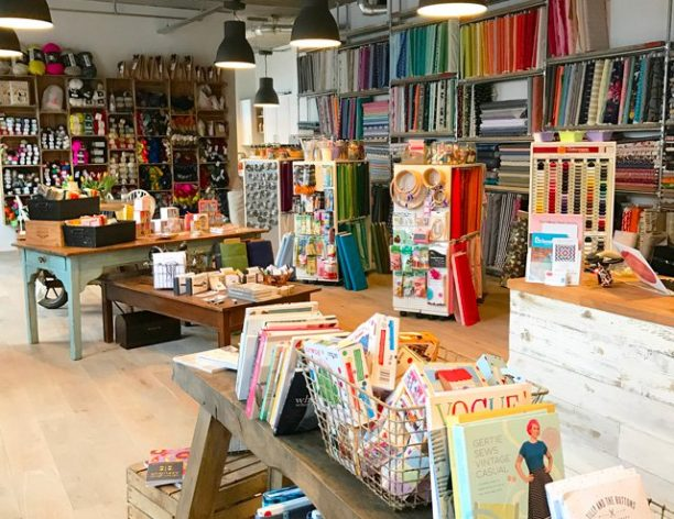 The shop floor of The Village Haberdashery in West Hampstead, full of fabrics, supplies and books for modern makers