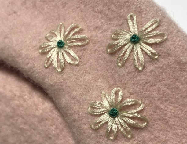 Detail of flowers embroidered on blush pink beret by Aimee Betts