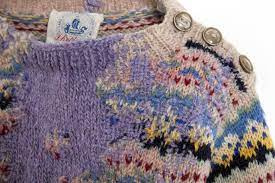 A mended jumper in contrasting wool darned by Celia Pym