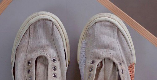 battered old trainers, repaired with a basket stitch and coloured twine